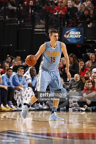 Nikola Jokic of the Denver Nuggets dribbles the ball against the Portland Trail Blazers on December 30 2015 at the Moda Center in Portland Oregon...