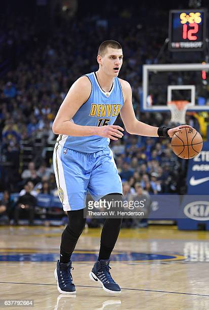 Nikola Jokic of the Denver Nuggets dribbles the ball against the Golden State Warriors during an NBA basketball game at ORACLE Arena on January 2...