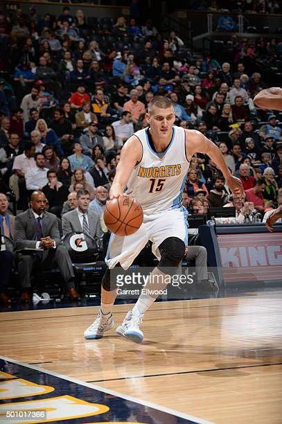 Nikola Jokic of the Denver Nuggets drives to the basket against the Minnesota Timberwolves on December 11 2015 at the Pepsi Center in Denver Colorado...