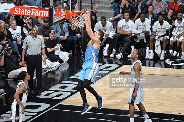 Nikola Jokic of the Denver Nuggets dunks the ball during a game against the San Antonio Spurs on January 19 2017 at the ATT Center in San Antonio...