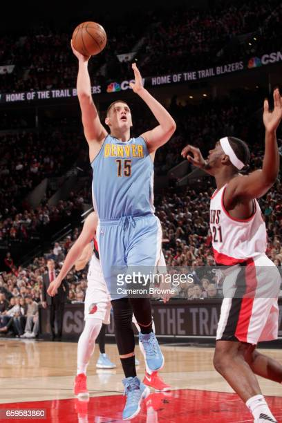 Nikola Jokic of the Denver Nuggets goes to the basket against the Portland Trail Blazers on March 28 2017 at the Moda Center in Portland Oregon NOTE...