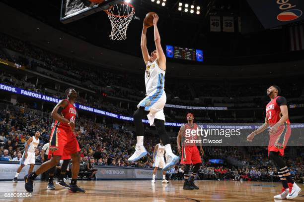 Nikola Jokic of the Denver Nuggets goes up for a dunk against the New Orleans Pelicans on March 26 2017 at the Pepsi Center in Denver Colorado NOTE...