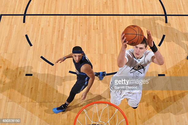 Nikola Jokic of the Denver Nuggets goes up for a lay up against the Dallas Mavericks on December 19 2016 at the Pepsi Center in Denver Colorado NOTE...