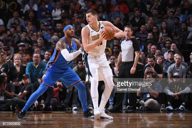Nikola Jokic of the Denver Nuggets handles the ball against Carmelo Anthony of the Oklahoma City Thunder on November 9 2017 at the Pepsi Center in...