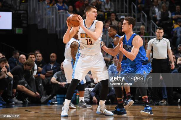 Nikola Jokic of the Denver Nuggets handles the ball against Dwight Powell of the Dallas Mavericks during the game on February 6 2017 at the Pepsi...