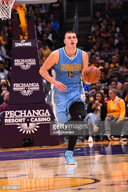 Nikola Jokic of the Denver Nuggets handles the ball against the Los Angeles Lakers during a preseason game on October 7 2016 at STAPLES Center in Los...