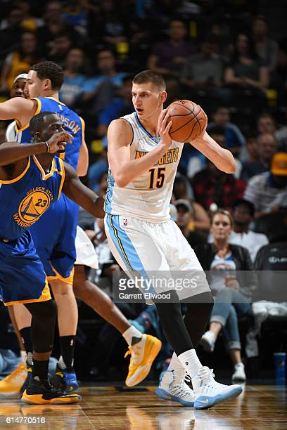 Nikola Jokic of the Denver Nuggets handles the ball against the Golden State Warriors on October 14 2016 at Pepsi Center in Denver Colorado NOTE TO...