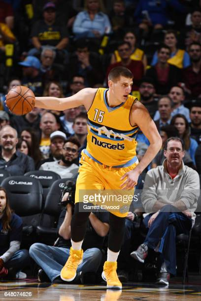 Nikola Jokic of the Denver Nuggets handles the ball against the Charlotte Hornets during the game on March 4 2017 at the Pepsi Center in Denver...