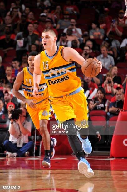 Nikola Jokic of the Denver Nuggets handles the ball during a game against the Houston Rockets on March 20 2017 at the Toyota Center in Houston Texas...
