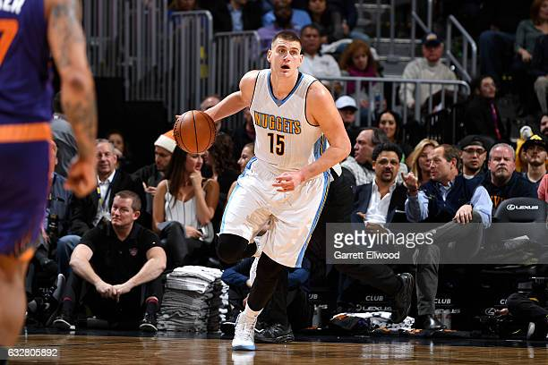 Nikola Jokic of the Denver Nuggets handles the ball during the game against the Phoenix Suns on January 26 2017 at the Pepsi Center in Denver...