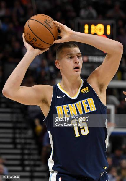 Nikola Jokic of the Denver Nuggets looks to pass the ball against the Utah Jazz at Vivint Smart Home Arena on October 18 2017 in Salt Lake City Utah...
