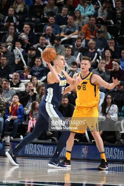 Nikola Jokic of the Denver Nuggets passes the ball against Jonas Jerebko of the Utah Jazz on November 28 2017 at vivintSmartHome Arena in Salt Lake...