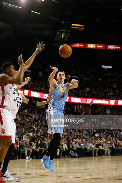 Nikola Jokic of the Denver Nuggets passes the ball against the Toronto Raptors on October 3 2016 at the Scotiabank Saddledome in Calagary Alberta...