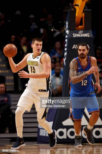 Nikola Jokic of the Denver Nuggets pulls down a rebound against the Oklahoma City Thunder at the Pepsi Center on October 10 2017 in Denver Colorado