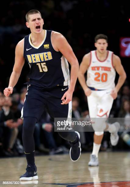 Nikola Jokic of the Denver Nuggets reacts after making a three point basket to tie the game in the third quarter against the New York Knicks during...