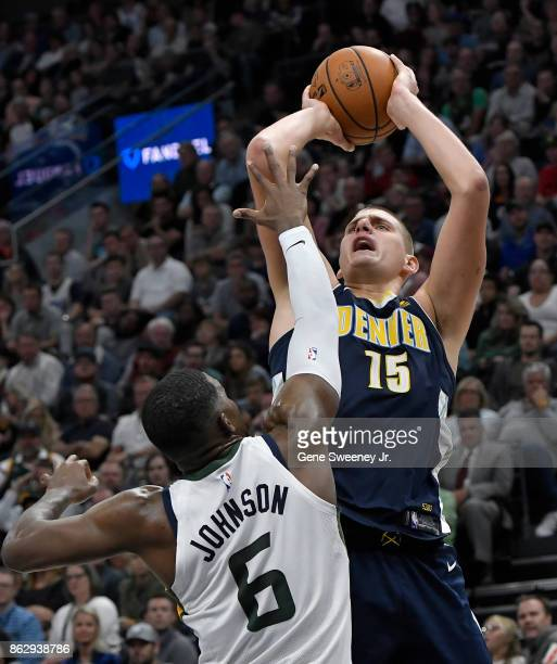 Nikola Jokic of the Denver Nuggets shoots over Joe Johnson of the Utah Jazz in the second half of the Nuggets 10696 loss at Vivint Smart Home Arena...