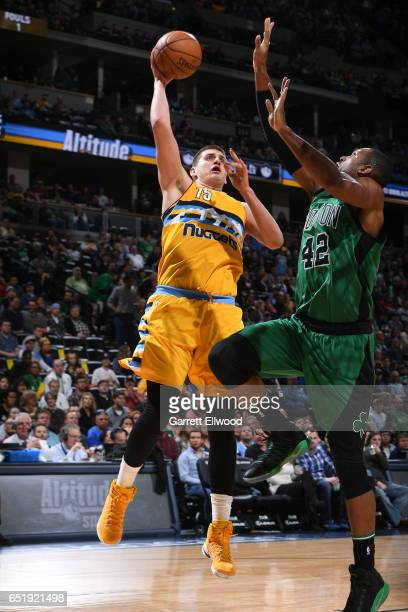 Nikola Jokic of the Denver Nuggets shoots the ball against the Boston Celtics on March 10 2017 at the Pepsi Center in Denver Colorado NOTE TO USER...