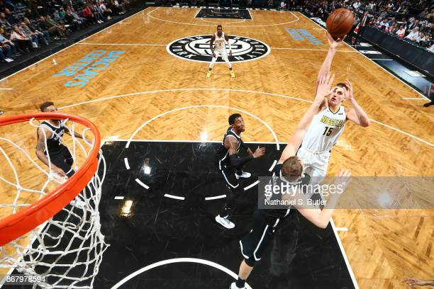 Nikola Jokic of the Denver Nuggets shoots the ball against the Brooklyn Nets on October 29 2017 at Barclays Center in Brooklyn New York NOTE TO USER...