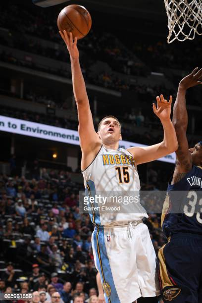 Nikola Jokic of the Denver Nuggets shoots the ball against the New Orleans Pelicans on April 7 2017 at the Pepsi Center in Denver Colorado NOTE TO...