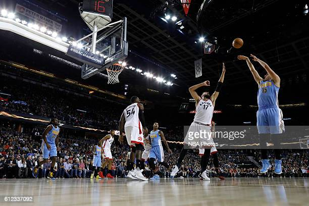 Nikola Jokic of the Denver Nuggets shoots the ball against the Toronto Raptors on October 3 2016 at the Scotiabank Saddledome in Calagary Alberta...