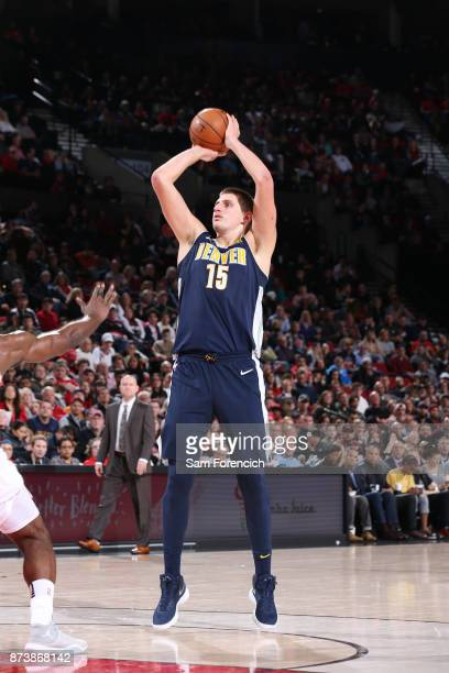Nikola Jokic of the Denver Nuggets shoots the ball against the Portland Trail Blazers on November 13 2017 at the Moda Center in Portland Oregon NOTE...