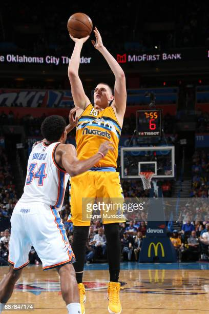 Nikola Jokic of the Denver Nuggets shoots the ball during the game against the Oklahoma City Thunder on April 12 2017 at Chesapeake Energy Arena in...