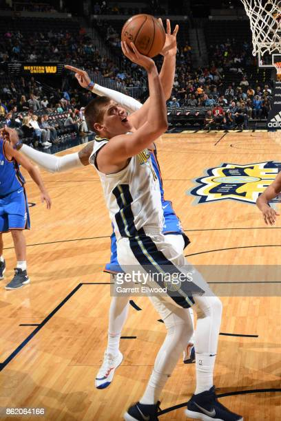 Nikola Jokic of the Denver Nuggets shoots the ball during the preseason game against the Oklahoma City Thunder on October 10 2017 at the Pepsi Center...