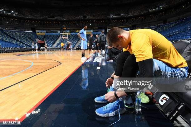 Nikola Jokic of the Denver Nuggets ties his shoes before practice on April 4 2017 at the Smoothie King Center in New Orleans Louisiana NOTE TO USER...