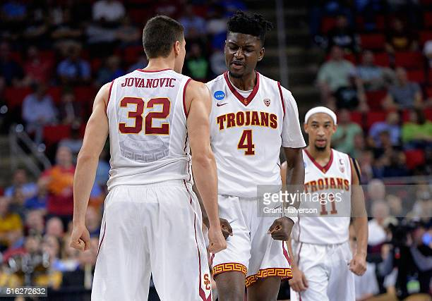 Nikola Jovanovic and Chimezie Metu of the USC Trojans celebrate a play in the second half against the Providence Friars during the first round of the...