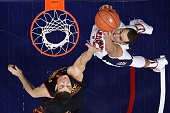 Nikola Jovanovic of the USC Trojans blocks a shot by Ryan Anderson of the Arizona Wildcats during the second half of the college basketball game at...