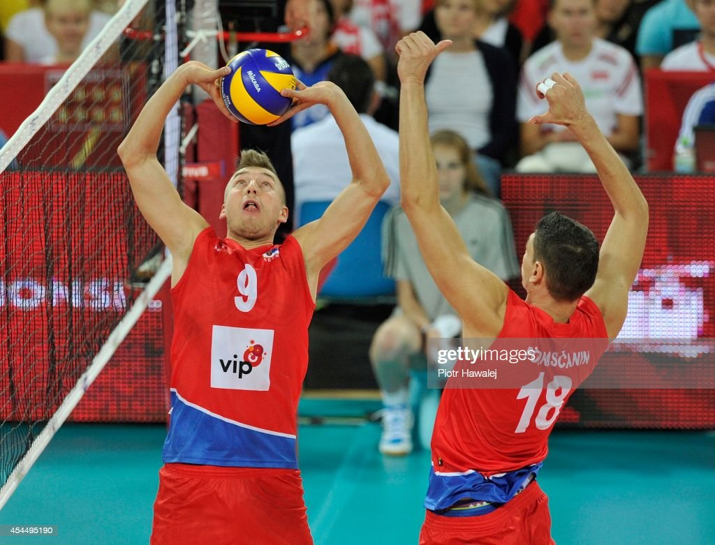 Nikola Jovovic of Serbia and Marco Podrascanin in action during the FIVB World Championships match between Serbia and Argentina on September 2, 2014 in Wroclaw, Poland.