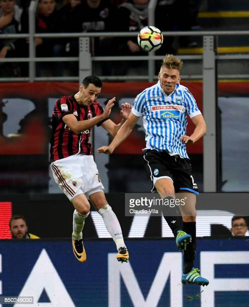 Nikola Kalinic of AC Milan and Bartosz Salamon of Spal compete for the ball during the Serie A match between AC Milan and Spal at Stadio Giuseppe...