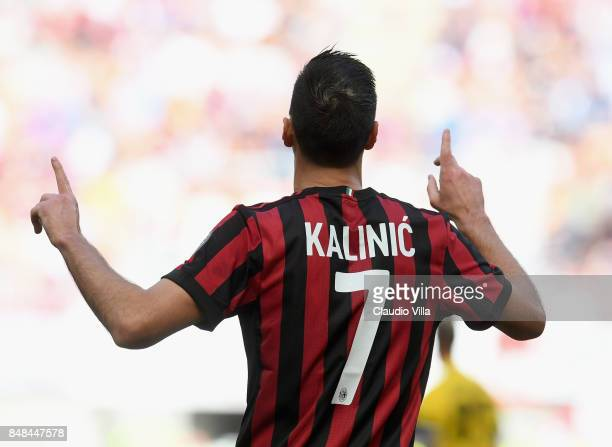 Nikola Kalinic of AC Milan celebrates after scoring the opening goal during the Serie A match between AC Milan and Udinese Calcio at Stadio Giuseppe...