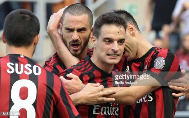 Nikola Kalinic of AC Milan celebrates his second goal with his teammate Giacomo Bonaventura Leonardo Bonucci and Suso during the Serie A match...