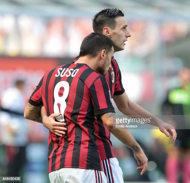 Nikola Kalinic of AC Milan celebrates with his teammate Suso after scoring the opening goal during the Serie A match between AC Milan and Udinese...