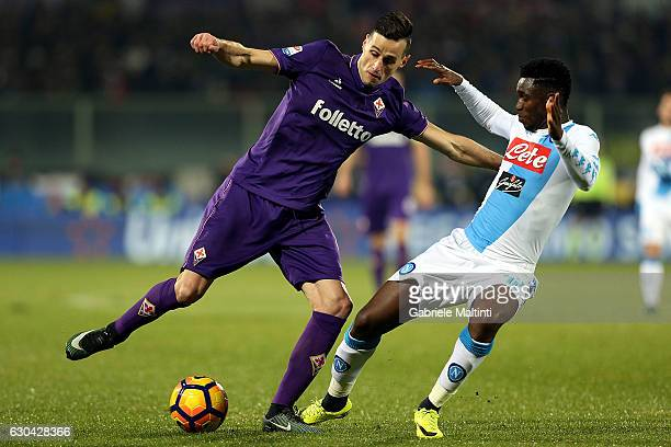 Nikola Kalinic of ACF Fiorentina battles for the ball with Amadou Diawara of SSC Napoli during the Serie A match between ACF Fiorentina and SSC...