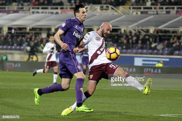 Nikola Kalinic of ACF Fiorentina battles for the ball with Arlind Ajeti of FC Torino during the Serie A match between ACF Fiorentina and FC Torino at...