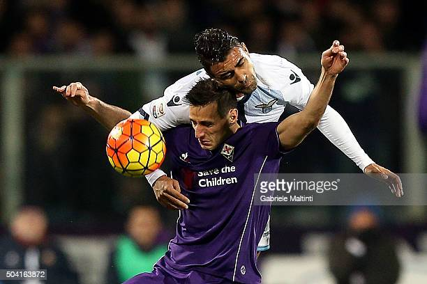 Nikola Kalinic of ACF Fiorentina battles for the ball with Mauricio of SS Lazio during the Serie A match between ACF Fiorentina and SS Lazio at...