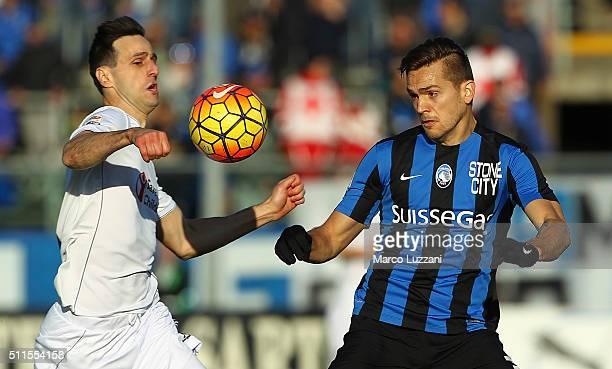 Nikola Kalinic of ACF Fiorentina competes for the ball with Rafael Toloi of Atalanta BC during the Serie A match between Atalanta BC and ACF...