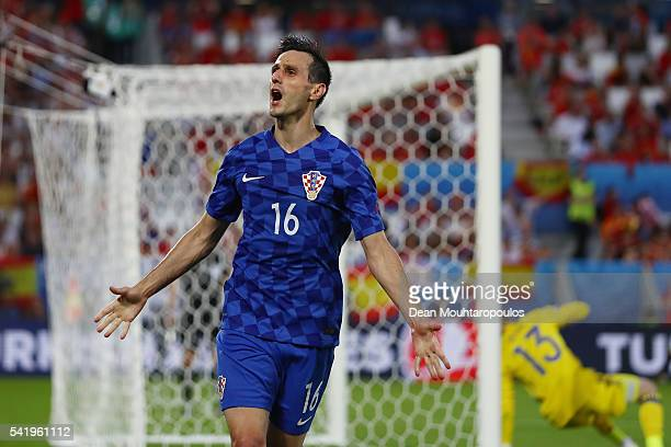 Nikola Kalinic of Croatia celebrates scoring his team's first goal during the UEFA EURO 2016 Group D match between Croatia and Spain at Stade Matmut...