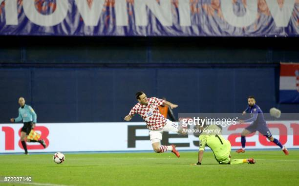 Nikola Kalinic of Croatia in action against Orestis Karnezis of Greece during the 2018 FIFA World Cup playoff qualification football match between...