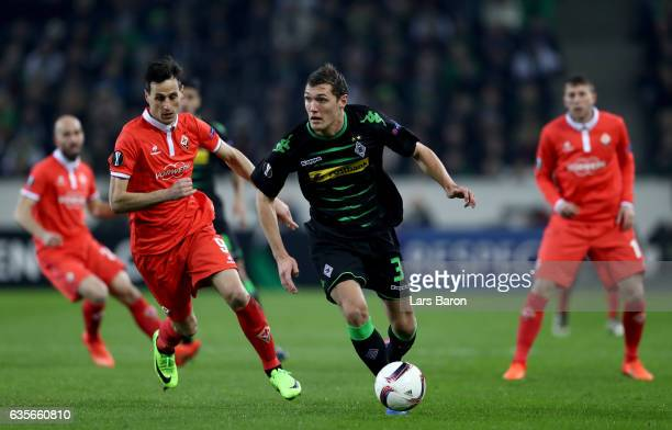 Nikola Kalinic of Fiorentina challenges Andreas Christensen of Moenchengladbach during the UEFA Europa League Round of 32 first leg match between...