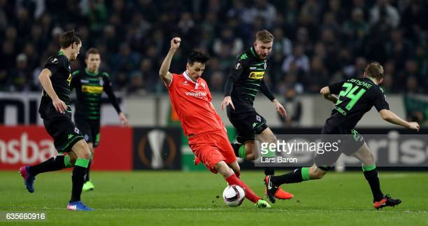 Nikola Kalinic of Fiorentina is challenged by Christoph Kramer of Moenchengladbach during the UEFA Europa League Round of 32 first leg match between...