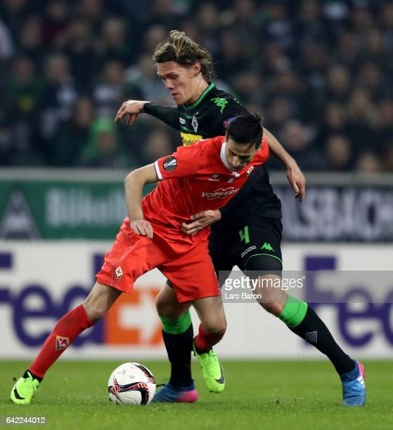 Nikola Kalinic of Fiorentina is challenged by Jannik Vestergaard of Moenchengladbach during the UEFA Europa League Round of 32 first leg match...