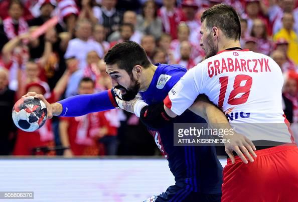 TOPSHOT Nikola Karabati of France is pushed by Piotr Grabarczyk of Poland vie during the Men's 2016 EHF European Handball Championships between...