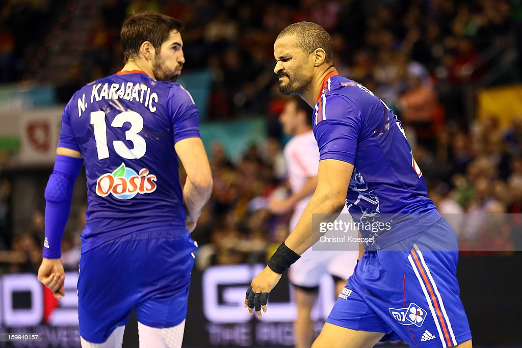 Nikola Karabatic and Cedric Sorhaindo of France look dejected during the quarterfinal match between France and Croatia at Pabellon Principe Felipe Arena on January 23, 2013 in Barcelona, Spain.