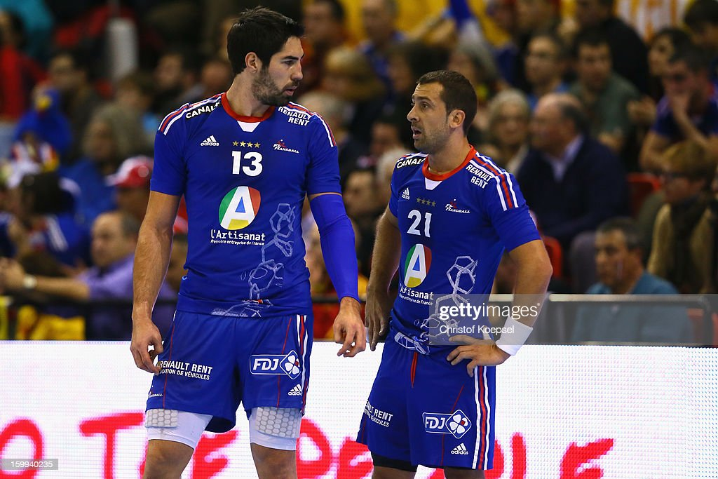 <a gi-track='captionPersonalityLinkClicked' href=/galleries/search?phrase=Nikola+Karabatic&family=editorial&specificpeople=620415 ng-click='$event.stopPropagation()'>Nikola Karabatic</a> and <a gi-track='captionPersonalityLinkClicked' href=/galleries/search?phrase=Michael+Guigou&family=editorial&specificpeople=791016 ng-click='$event.stopPropagation()'>Michael Guigou</a> of France look dejected during the quarterfinal match between France and Croatia at Pabellon Principe Felipe Arena on January 23, 2013 in Barcelona, Spain.