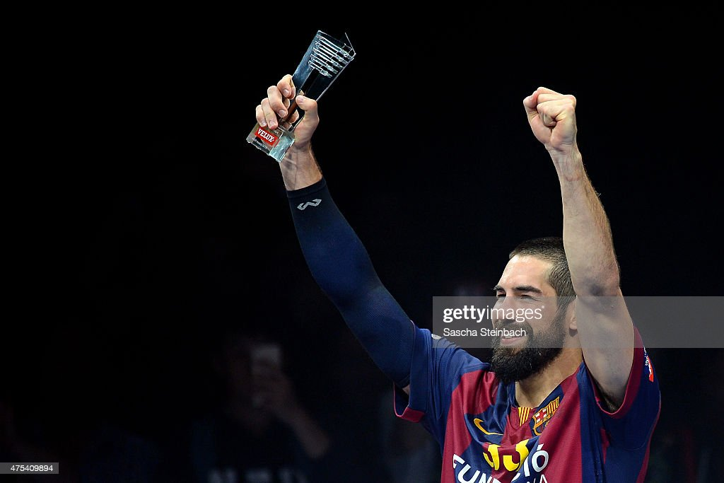 <a gi-track='captionPersonalityLinkClicked' href=/galleries/search?phrase=Nikola+Karabatic&family=editorial&specificpeople=620415 ng-click='$event.stopPropagation()'>Nikola Karabatic</a> of Barcelona celebrates with the MVP trophy after winning the 'VELUX EHF FINAL4' final match against MKB-MVM Veszprem at Lanxess Arena on May 31, 2015 in Cologne, Germany.