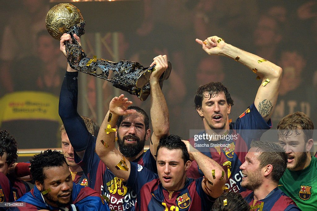 <a gi-track='captionPersonalityLinkClicked' href=/galleries/search?phrase=Nikola+Karabatic&family=editorial&specificpeople=620415 ng-click='$event.stopPropagation()'>Nikola Karabatic</a> (L) of Barcelona celebrates with the trophy after winning the 'VELUX EHF FINAL4' final match against MKB-MVM Veszprem at Lanxess Arena on May 31, 2015 in Cologne, Germany.