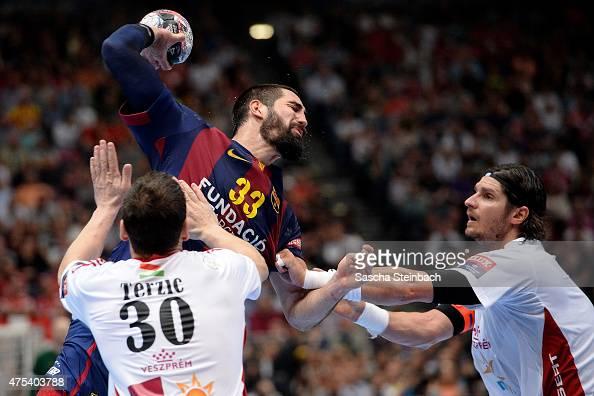 Nikola Karabatic of Barcelona is challenged by Mirsad Terzic and Laszlo Nagy of Veszprem during the 'VELUX EHF FINAL4' final match between FC...